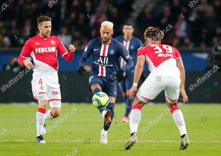 PSG's Neymar, center, is challenged by Monaco's Cesc Fabregas, left, and Benjamin Henrichs during the French League One soccer match between Paris-Saint-Germain and Monaco at the Parc des Princes stadium in Paris