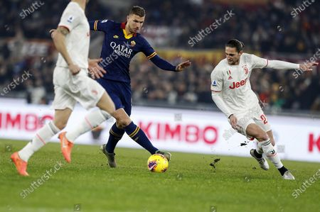 Roma's Edin Dzeko (L) in action against Juventus' Adrien Rabiot (R) during Serie A soccer match Roma - Juventus at Olimpico Stadium in Rome, ITaly, 12 January 2020.