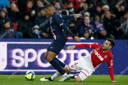 Paris Saint Germain's Kylian Mbappe (L) and Monaco's Cesc Fabregas (R) in action during the French Ligue 1 soccer match between PSG and Monaco at the Parc des Princes stadium in Paris, France, 12 January 2020.