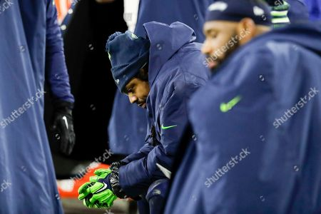 Seattle Seahawks' Marshawn Lynch sits on the bench during the second half an NFL divisional playoff football game against the Green Bay Packers, in Green Bay, Wis. The Packers won 28-23 to advance to the NFC Championship