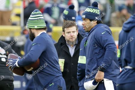 Seattle Seahawks general manager John Schneider watches warm ups before an NFL divisional playoff football game against the Green Bay Packers, in Green Bay, Wis