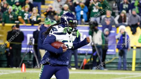 Seattle Seahawks' Marshawn Lynch warms up before an NFL divisional playoff football game against the Green Bay Packers, in Green Bay, Wis