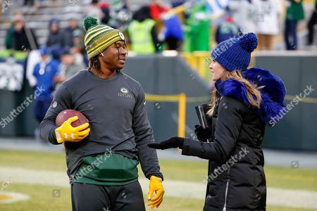 Fox TV reporter Erin Andrews talks to Green Bay Packers' Jamaal Williams before an NFL divisional playoff football game against the Seattle Seahawks, in Green Bay, Wis