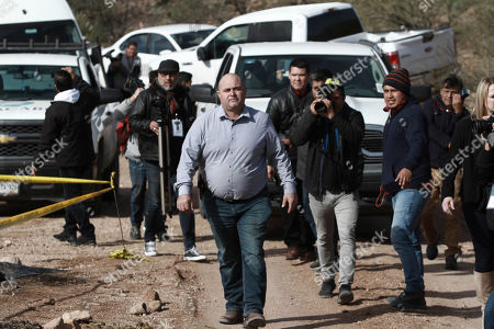 Stock Photo of Julian Le Baron arrives where one of the cars belonging to the extended LeBaron family was ambushed by gunmen last year near Bavispe, Sonora state, Mexico, . Lopez Obrador said Sunday there is an agreement to establish a monument will be put up to memorialize nine U.S.-Mexican dual citizens ambushed and slain last year by drug gang assassins along a remote road near New Mexico