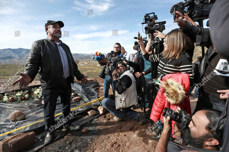 Adrian LeBaron speaks to reporters in the place where one of the cars belonging to the extended LeBaron family was ambushed by gunmen last year near Bavispe, Sonora state, Mexico, . Lopez Obrador said Sunday there is an agreement to establish a monument will be put up to memorialize nine U.S.-Mexican dual citizens ambushed and slain last year by drug gang assassins along a remote road near New Mexico