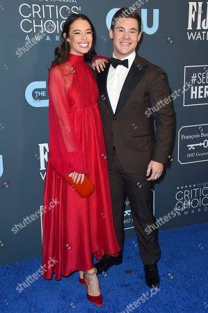Chloe Bridges, Adam Devine. Chloe Bridges, left, and Adam Devine arrive at the 25th annual Critics' Choice Awards, at the Barker Hangar in Santa Monica, Calif