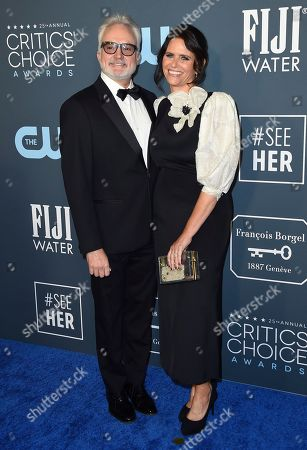 Stock Image of Bradley Whitford, Amy Landecker. Bradley Whitford, left, and Amy Landecker arrive at the 25th annual Critics' Choice Awards, at the Barker Hangar in Santa Monica, Calif