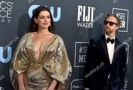 Adam Shulman, Anne Hathaway. Anne Hathaway, left, and Adam Shulman arrive at the 25th annual Critics' Choice Awards, at the Barker Hangar in Santa Monica, Calif