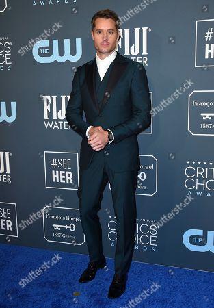 Justin Hartley arrives at the 25th annual Critics' Choice Awards, at the Barker Hangar in Santa Monica, Calif