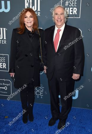 Henry Winkler, Stacey Weitzman. Stacey Weitzman, left, and Henry Winkler arrive at the 25th annual Critics' Choice Awards, at the Barker Hangar in Santa Monica, Calif