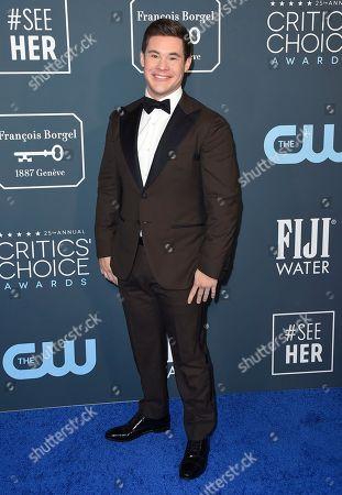Adam Devine arrives at the 25th annual Critics' Choice Awards, at the Barker Hangar in Santa Monica, Calif