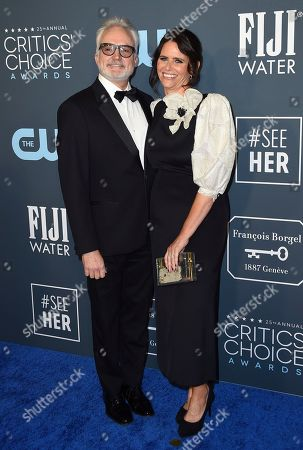 Bradley Whitford, Amy Landecker. Bradley Whitford, left, and Amy Landecker arrive at the 25th annual Critics' Choice Awards, at the Barker Hangar in Santa Monica, Calif