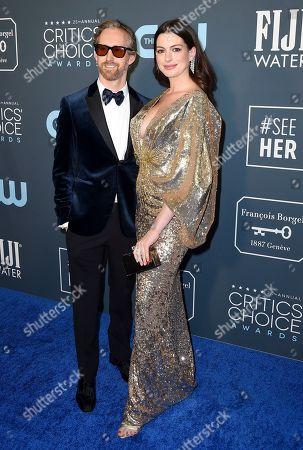 Adam Shulman, Anne Hathaway. Adam Shulman, left, and Anne Hathaway arrive at the 25th annual Critics' Choice Awards, at the Barker Hangar in Santa Monica, Calif