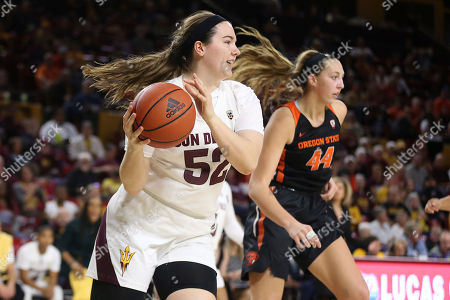 Arizona State's Jamie Ruden (52) looks to pass after winning a rebound against Oregon State's Taylor Jones (44) during the first half of an NCAA college basketball game, in Tempe, Ariz