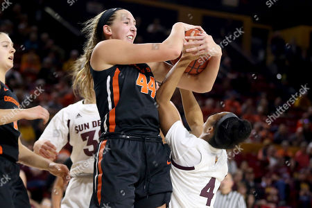 Stock Picture of Oregon State's Taylor Jones (44) wins a rebound over Arizona State's Kiara Russell (4) during the second half of an NCAA college basketball game, in Tempe, Ariz