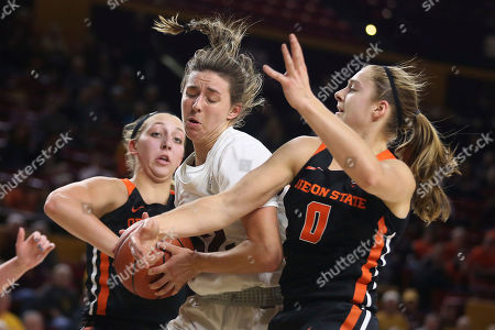 Stock Photo of Arizona State's Jayde Van Hyfte (32 ) is double-teamed by Oregon State's Taylor Jones (44) and Mikayla Pivec (0) during the second half of an NCAA college basketball game, in Tempe, Ariz