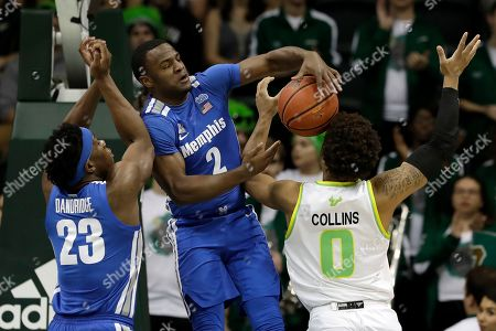 Alex Lomax, David Collins. Memphis guard Alex Lomax (2) blocks a shot by South Florida guard David Collins (0) during the first half of an NCAA college basketball game, in Tampa, Fla