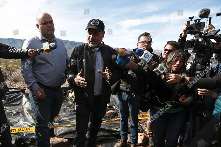Julian, left, and Adrian LeBaron, center, meet with reporters in the place where one of the cars belonging to the extended LeBaron family was ambushed by gunmen last year near Bavispe, Sonora state, Mexico, . Lopez Obrador said Sunday there is an agreement to establish a monument will be put up to memorialize nine U.S.-Mexican dual citizens ambushed and slain last year by drug gang assassins along a remote road near New Mexico