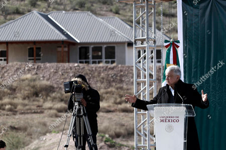 Mexico's President Andres Manuel Lopez Obrador speaks during his visit to the small town of La Mora, Sonora state, Mexico, . Lopez Obrador said Sunday there is an agreement to establish a monument will be put up to memorialize nine U.S.-Mexican dual citizens ambushed and slain last year by drug gang assassins along a remote road near New Mexico
