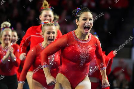Georgia gymnasts including Georgia gymnast Sabrina Vega, front, celebrate during an NCAA gymnastics meet against LSU on in Athens, Ga