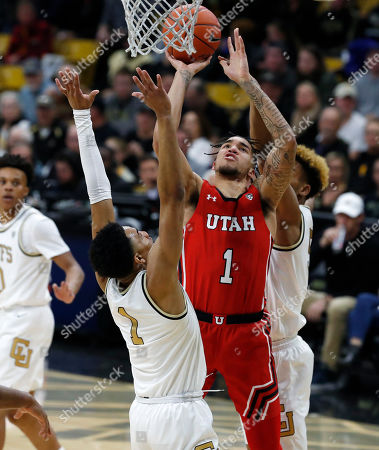 R m. Utah forward Timmy Allen, center, goes up for a basket between Colorado guards D'Shawn Schwartz, back, and Tyler Bey in the first half of an NCAA college basketball game, in Boulder, Colo