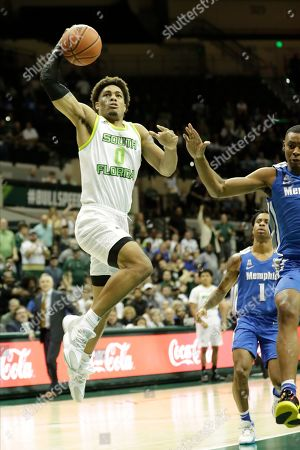 South Florida guard David Collins (0) goes up for a dunk against Memphis during the second half of an NCAA college basketball game, in Tampa, Fla. Memphis won the game 68-64