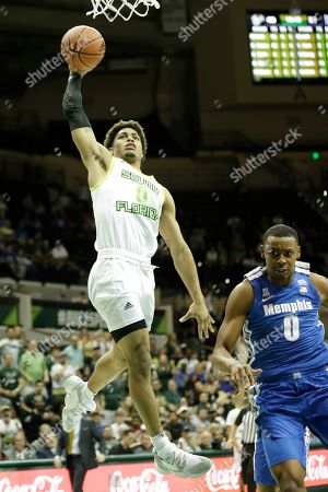 South Florida guard David Collins, left, goes up for a dunk in front of Memphis forward D.J. Jeffries during the second half of an NCAA college basketball game, in Tampa, Fla. Memphis won the game 68-64