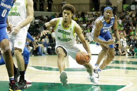 South Florida guard David Collins (0) drives past Memphis forward Precious Achiuwa (55) during the second half of an NCAA college basketball game, in Tampa, Fla. Memphis won the game 68-64