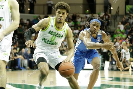 South Florida guard David Collins (0) drives around Memphis forward Precious Achiuwa (55) during the second half of an NCAA college basketball game, in Tampa, Fla. Memphis won the game 68-64