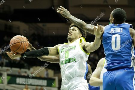 South Florida guard David Collins, left, goes up for a shot against Memphis forward D.J. Jeffries during the second half of an NCAA college basketball game, in Tampa, Fla. Memphis won the game 68-64