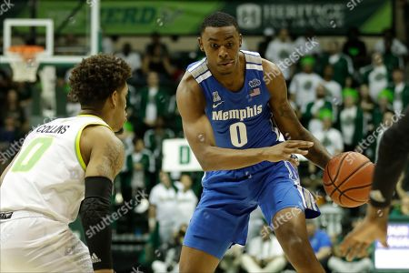 Memphis forward D.J. Jeffries, right, drives against South Florida guard David Collins during the first half of an NCAA college basketball game, in Tampa, Fla