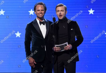 Walton Goggins, Chris Hardwick. Walton Goggins, left, and Chris Hardwick present the award for best actor in a drama series at the 25th annual Critics' Choice Awards, at the Barker Hangar in Santa Monica, Calif