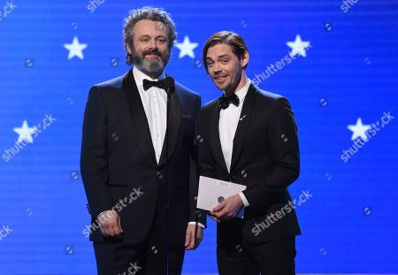 Michael Sheen, Tom Payne. Michael Sheen, left, and Tom Payne present the award for best actress in a comedy series at the 25th annual Critics' Choice Awards, at the Barker Hangar in Santa Monica, Calif