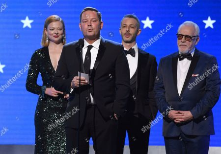 "Kevin J. Messick, Sarah Snook, Jeremy Strong, Brian Cox. Sarah Snook, from left, Kevin J. Messick, Jeremy Strong and Brian Cox of ""Succession"" accept the award for best drama series at the 25th annual Critics' Choice Awards, at the Barker Hangar in Santa Monica, Calif"
