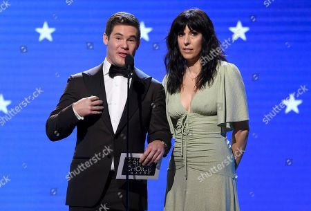 Stock Photo of Adam Devine, Edi Patterson. Adam Devine, left, and Edi Patterson present the award for best drama series at the 25th annual Critics' Choice Awards, at the Barker Hangar in Santa Monica, Calif