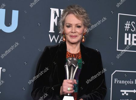 "Jean Smart, winner of the award for best supporting actress in a drama series for ""Watchmen,"" poses in the press room at the 25th annual Critics' Choice Awards, at the Barker Hangar in Santa Monica, Calif"