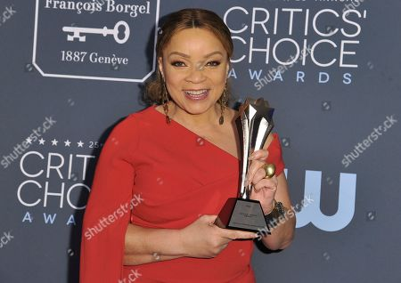 """Ruth E. Carter poses in the press room with the award for best costume design for """"Dolemite Is My Name"""" at the 25th annual Critics' Choice Awards, at the Barker Hangar in Santa Monica, Calif"""