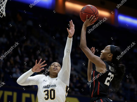 Haley Jones, Kiana Williams. Stanford's Kiana Williams, right, shoots against California's CJ West (30) in the first half of an NCAA college basketball game, in Berkeley, Calif