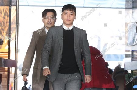 South Korean singer Seungri (R), a former member of BigBang, arrives for an arrest warrant hearing at the Seoul Central District Court in Seoul, South Korea, 13 January 2020. Seungri is facing charges of procuring prostitutes and gambling.