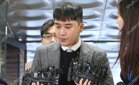 Stock Picture of South Korean singer Seungri (C), a former member of BigBang, speaks to the media as he arrives for an arrest warrant hearing at the Seoul Central District Court in Seoul, South Korea, 13 January 2020. Seungri is facing charges of procuring prostitutes and gambling.