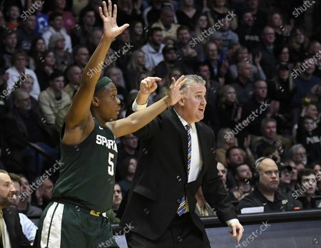 West Lafayette, Indiana, USA; Purdue Boilermakers head coach Matt Painter is pointing out to his team that Michigan State Spartans guard Cassius Winston (5) is unguarded in the corner in the first half of a basketball game between the Michigan State Spartans and the Purdue Boilermakers at Mackey Arena. Mandatory Credit: Sandra Dukes-CSM
