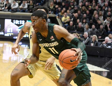 West Lafayette, Indiana, USA; Michigan State Spartans forward Aaron Henry (11) drives past Purdue Boilermakers guard Brandon Newman (5) in the first half at Mackey Arena. Mandatory Credit: Sandra Dukes-CSM