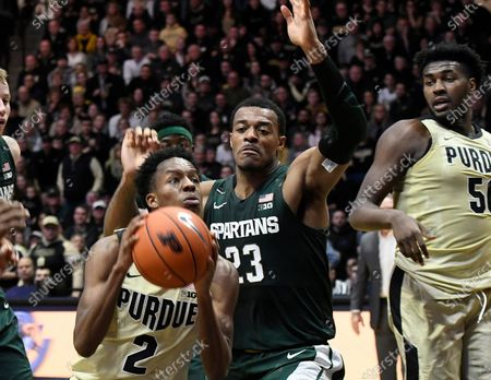 West Lafayette, Indiana, USA; Purdue Boilermakers guard Eric Hunter Jr. (2) drives to the basket past Michigan State Spartans forward Xavier Tillman (23) as Trevion Williams (50) watches in the first half at Mackey Arena. Mandatory Credit: Sandra Dukes-CSM
