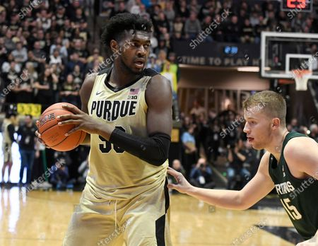 West Lafayette, Indiana, USA; Purdue Boilermakers forward Trevion Williams (50) looks to drive past Michigan State Spartans forward Thomas Kithier (15) in the first half at Mackey Arena. Mandatory Credit: Sandra Dukes-CSM