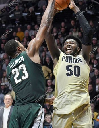 West Lafayette, Indiana, USA; Purdue Boilermakers forward Trevion Williams (50) shoots over the outstretched arm of Michigan State Spartans forward Xavier Tillman (23) in the first half at Mackey Arena. Mandatory Credit: Sandra Dukes-CSM