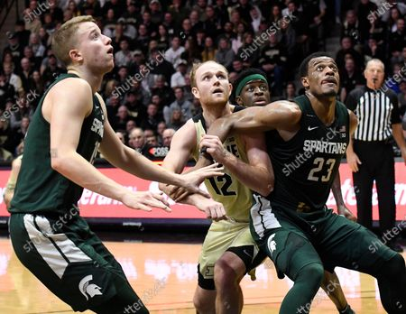 West Lafayette, Indiana, USA; Purdue Boilermakers forward Evan Boudreaux (12), Michigan State Spartans forward Xavier Tillman (23) and forward Thomas Kithier (15) wait for a rebound in the first half at Mackey Arena. Mandatory Credit: Sandra Dukes-CSM