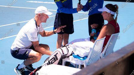 Anett Kontaveit of Estonia listens to coach Nigel Sears