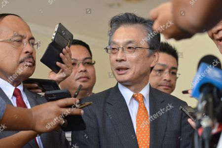 Japan's ambassador to Malaysia Hiroshi Oka speaks to waiting media outside the Putrajaya hospital in Putrajaya, Malaysia, . World top badminton player Kento Momota from Japan, was lightly injured during a car accident in Malaysia early Monday