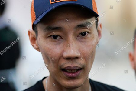 Malaysian former badminton player Lee Chong Wei speaks to media after visiting Kento Momota at the Putrajaya hospital in Putrajaya, Malaysia, . World top badminton player Momota from Japan, was injured during a car accident in Malaysia early Monday