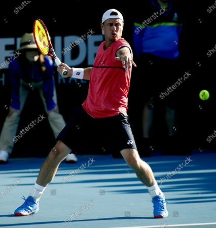 Lleyton Hewitt of Australia against Christian Garin of and Juan Ignacio Londero of Argentina during day 2 of the Adelaide International tennis tournament at Memorial Drive Tennis Centre inAdelaide, Australia, 13 January 2020.